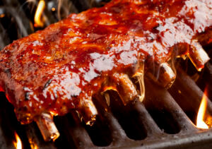 Ribs-On-Grill-with-Sauce